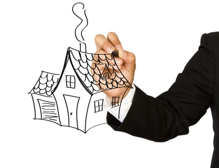 Business hand with pen drawing a house photo