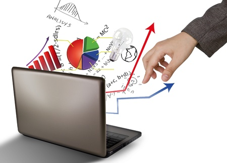 investment goals: Laptop and financial Graphs