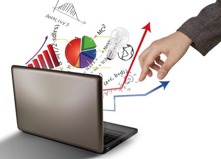 Portátil y gráficos financieros Foto de archivo