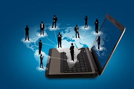 Social networking concept : Laptop with social network on world map photo