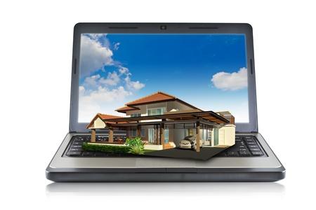 House on laptop isolated on white background Stock Photo - 10734494