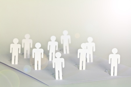 Social Network concept : close up of people cut out of paper on white background Stock Photo - 10734509