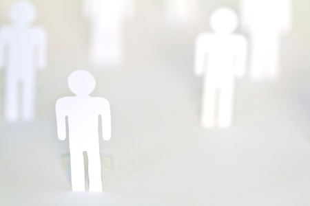 Social Network concept : close up of people cut out of paper on white background photo