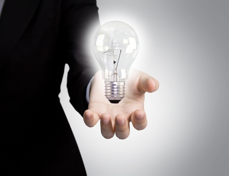 Business man holding light bulb in his hand Stock Photo - 10944803