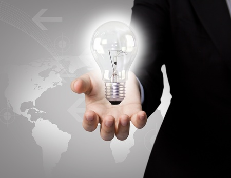 Business man holding light bulb in his hand Stock Photo - 10901207