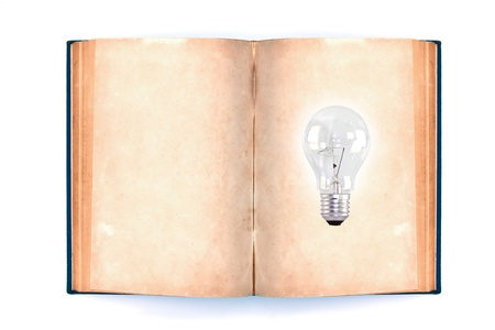 Old book and light bulb, isolated on white background Stock Photo - 10944817
