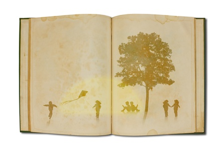 Children playing on old book with tree photo