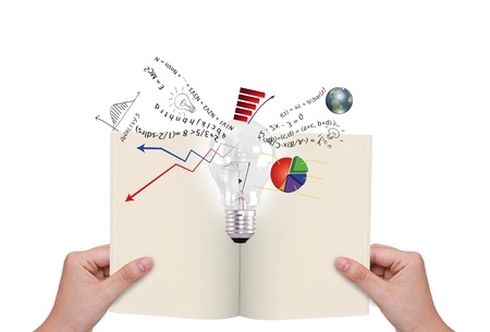 double page spread: Hands holding book with light bulb and business graph out
