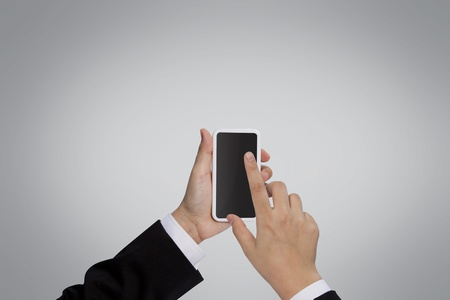 phone button: Businessman holding mobile phone Stock Photo