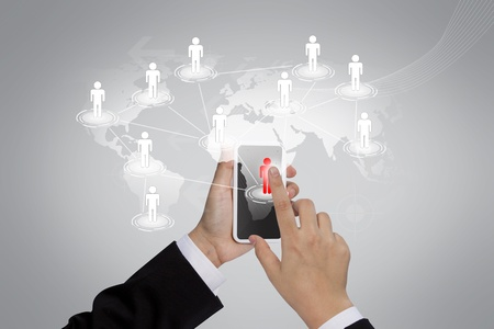 Business Hand holding a phone show the social network photo