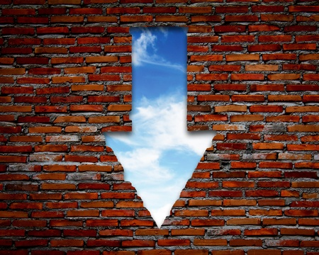 Brick wall with up arrow ,sky. photo