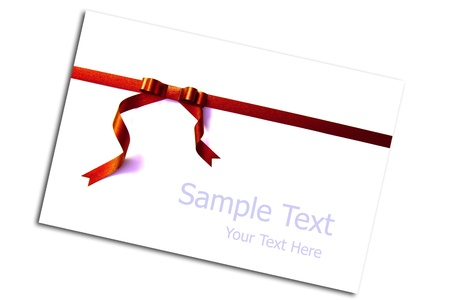 Blank card tied with a bow of red ribbon. Isolated on white, with soft shadow. photo