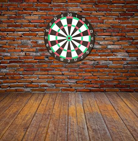 Dartboard on brick wall photo