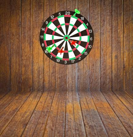 Dartboard on brick wall (miss darts) photo