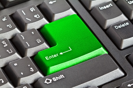 Computer keyboard - Green key Enter, close-up photo