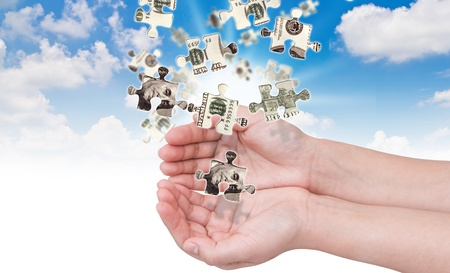 Hands and dollar money puzzle Stock Photo - 11193354