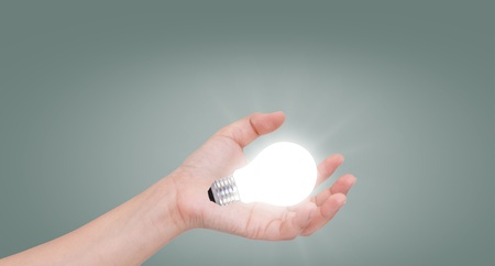 Women hand with lamp bulb Stock Photo - 11193304
