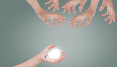 Women hand with lamp bulb photo