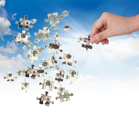 Hands and dollar money puzzle Stock Photo - 11193331