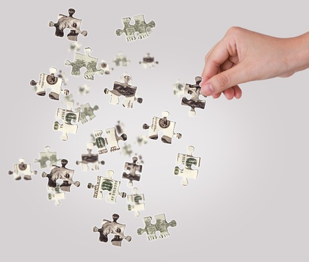 Hands and dollar money puzzle photo
