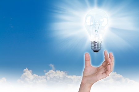 Business hand with Light bulb over blue sky Stock Photo - 11173992