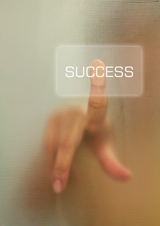 Woman finger push success button photo
