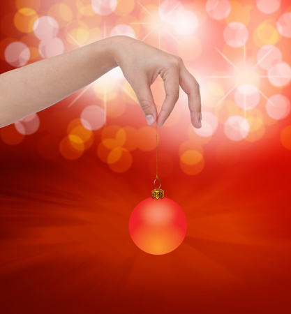 Human hand holding christmas ball photo