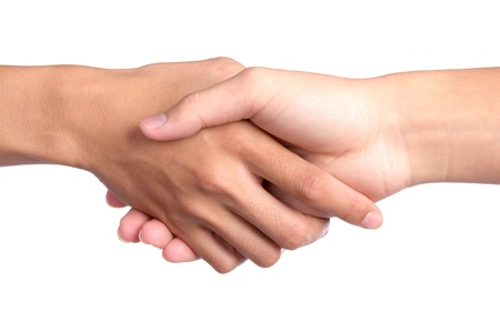 hands joined: Closeup picture of shaking hands on white background