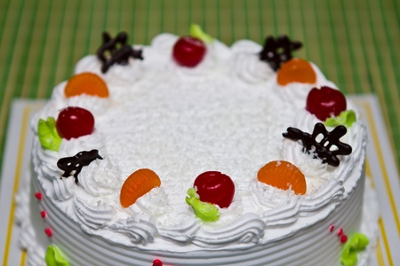 White Cream Cake with Fruits and Chocolate photo