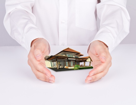 Two hands hold house Stock Photo - 11424952