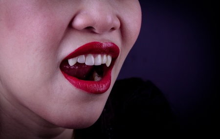 Halloween Vampire Woman over black background photo