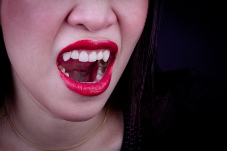 Halloween Vampire Woman over black background Stock Photo - 11432633