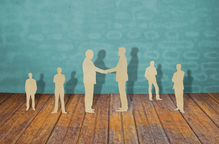 cross linked: Paper cut of two business man shake hand