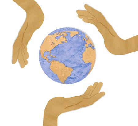Eco concept : recycled paper cut of three hand hold earth Stock Photo - 11424759