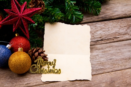Christmas decoration with blank vintage old paper over old wood background photo