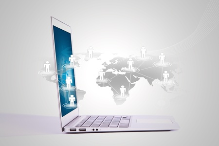Social networking concept : Laptop with social network on world map Stock Photo - 11747702