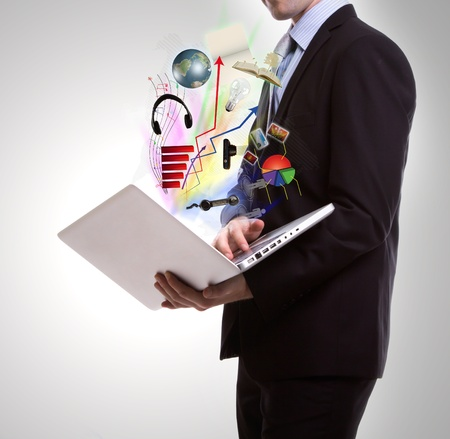 Business man with laptop photo