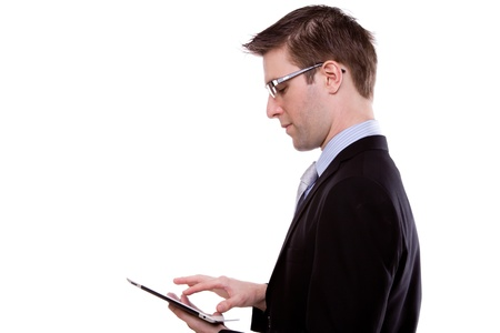 Portrait of young business man using a touch screen device against white background Stock Photo - 11863557