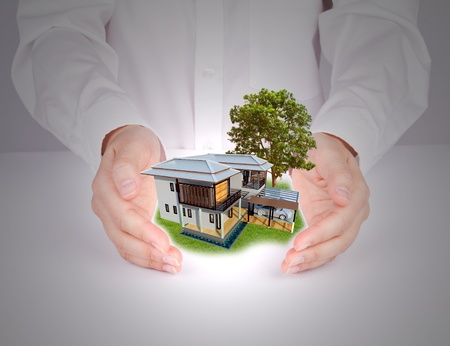 Business hand holding house Stock Photo - 11863569