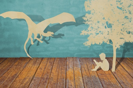 Paper cut of children read a book under tree and dragon photo
