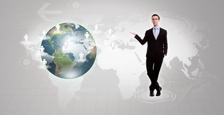 Social Network concept :young business man holding earth of social network photo