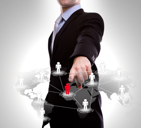 Social Network concept : business man point to social network and world map photo
