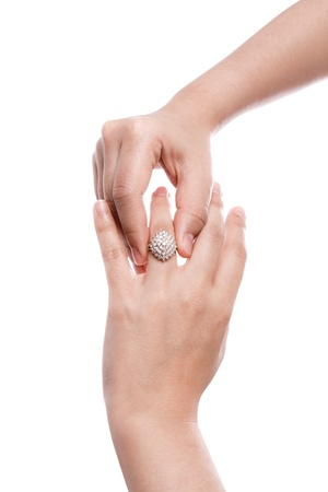 Engagement Ring in hand isolate on white background photo