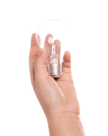 Light bulb in hand isolated on a white background photo