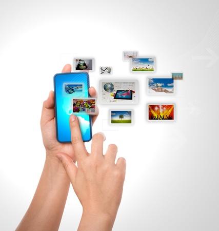 Mobile phone With hand Фото со стока