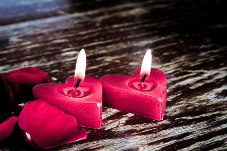 Valentines candles on rose petals background photo