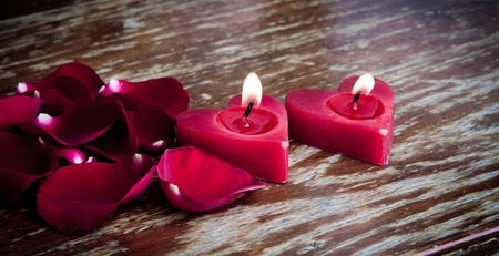 Valentines candles on rose petals background Stock Photo - 11993608