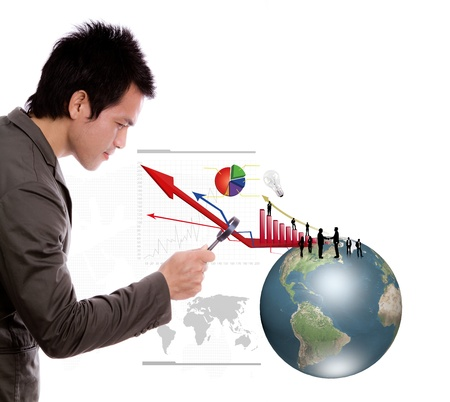 financial globe: Business man look earth and business graph under a magnifying glass