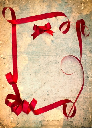 Grunge vintage old paper and red ribbon photo