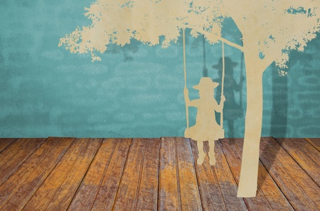 Paper cut of children on swing under tree photo